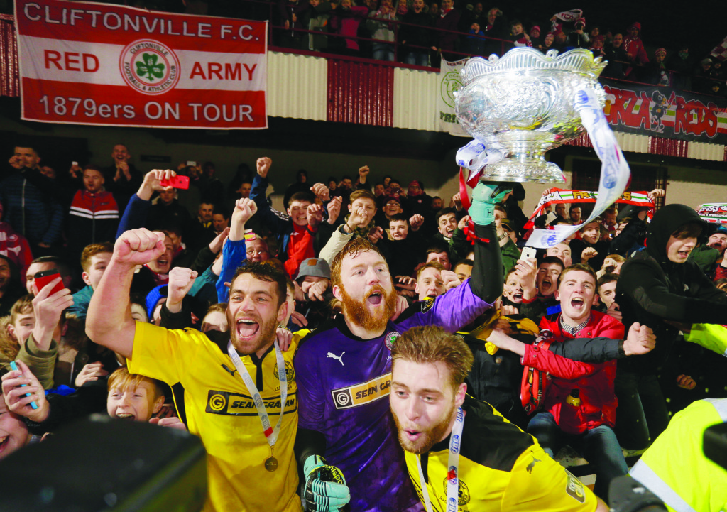 Cliftonville players celebrate with the fans after Saturday's League Cup final victory over Ards at Solitude
