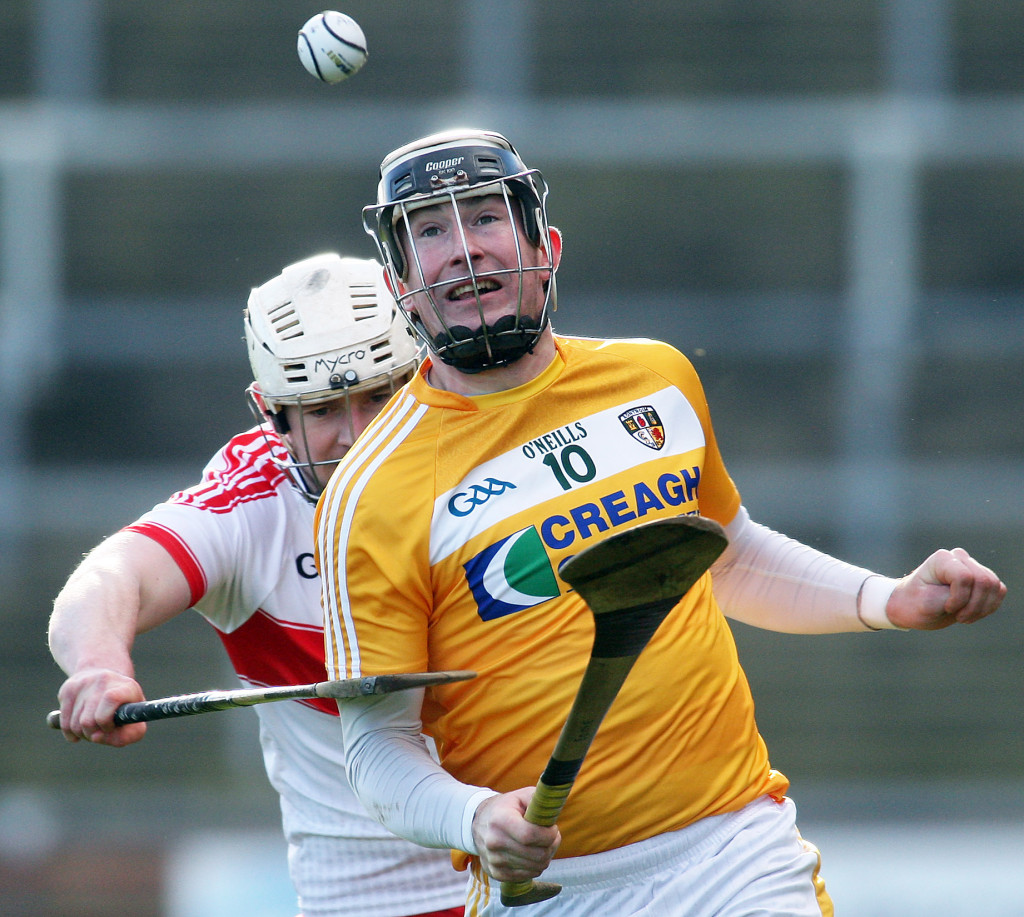 Antrim's Eddie McCloskey and Derry's Dermot O'Neill tussle for possession