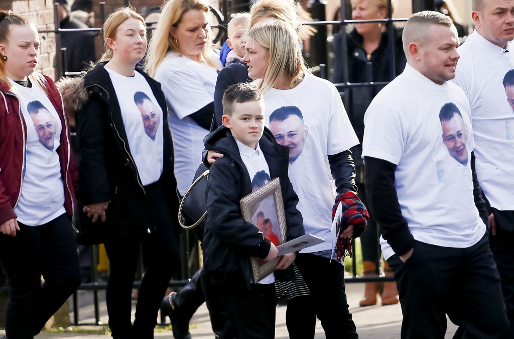 Mourners, including Stephen Carson's fiancée and sons, wore t-shirts bearing the dead man's picture    Pic by Kevin Scott Belfast , UK - March 05, Pictured is the funeral of Murder victim Stephen Carson at Holy Trinity Church in west Belfast on March 05, 2016  Belfast, Northern Ireland ( Photo by Kevin Scott / Presseye)