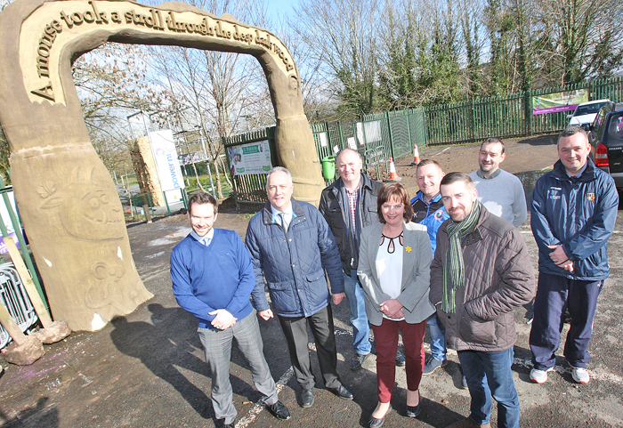 Colin O'Neill, Chief Executive Colin Glen Trust, with Paul Kelly, Colin Valley FC, Keith McCaugherty and Cuan O'Neill, Saints Youth Club, local councillors Seanna Walsh, Stephen Magennis and Matt Garrett and Jennifer McCann MLA