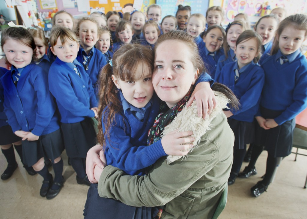 Holly McDowell back to school for the first time since open heart surgery with Mother Hanna