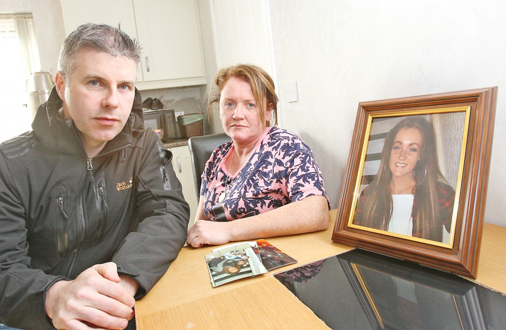 Noreen Lavery and Cllr Stevie Corr with family photos of Caoimhe, a mother-of-two who took her own life aged 21 after battling mental illness