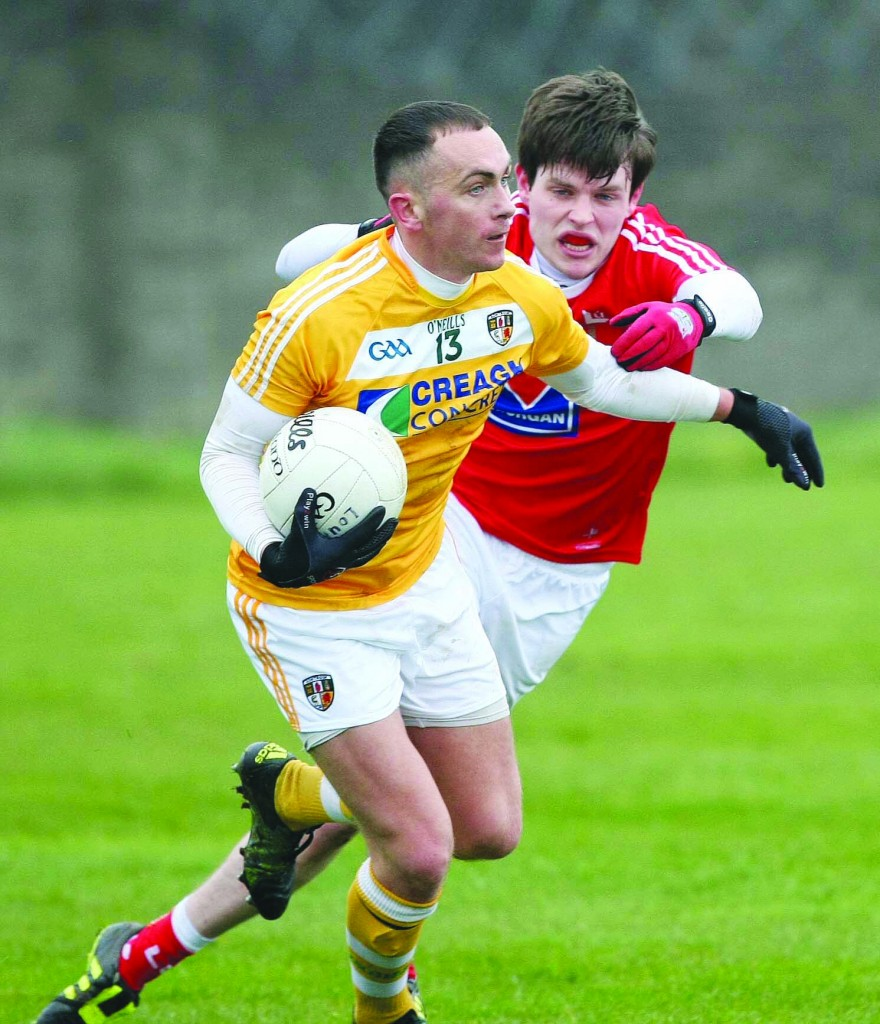 Brian Neeson breaks a tackle during Antrim's draw with Louth on Sunday. The sides meet again at Croke Park on April 23