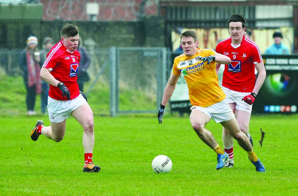 Sunday 3rd April 2016National Football League Division FourCorrigan Park, Whiterock Rd, BelfastAntrim v Louth Antrim's Mark Sweeney Louth's Derek Crilly and Tommy Durnin