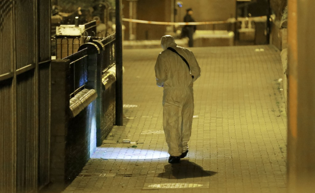 A PSNI forensic officer at the scene of the shooting of Michael McGibbon