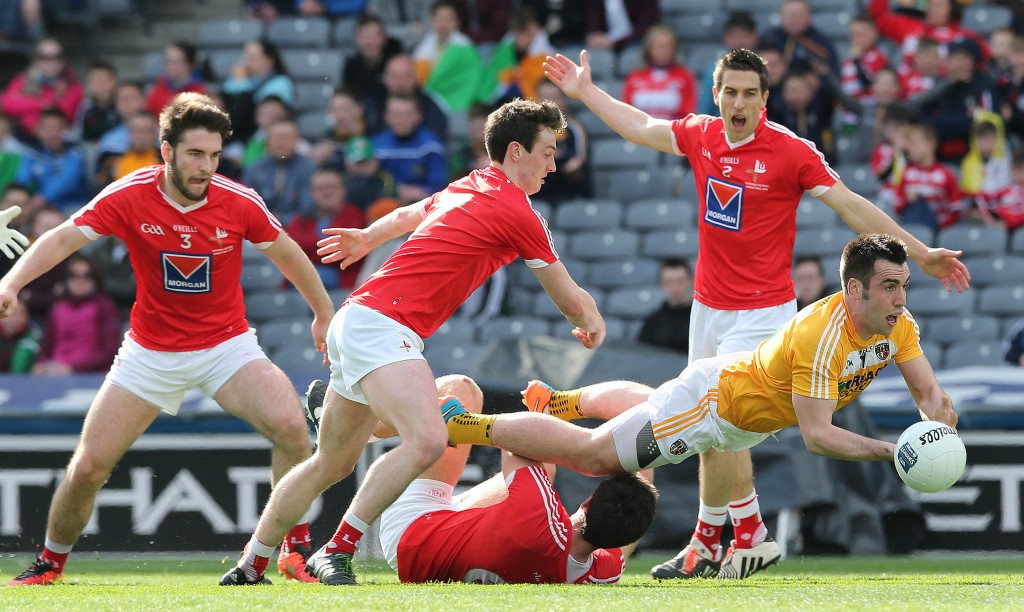 Antrim's Kevin Niblock gets the ball away under pressure during Saturday's Division Four final defeat to Louth at Croke Park