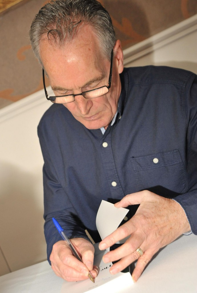 Gerry Kelly signs a copy of his book 'The Escape' when it was released three years ago