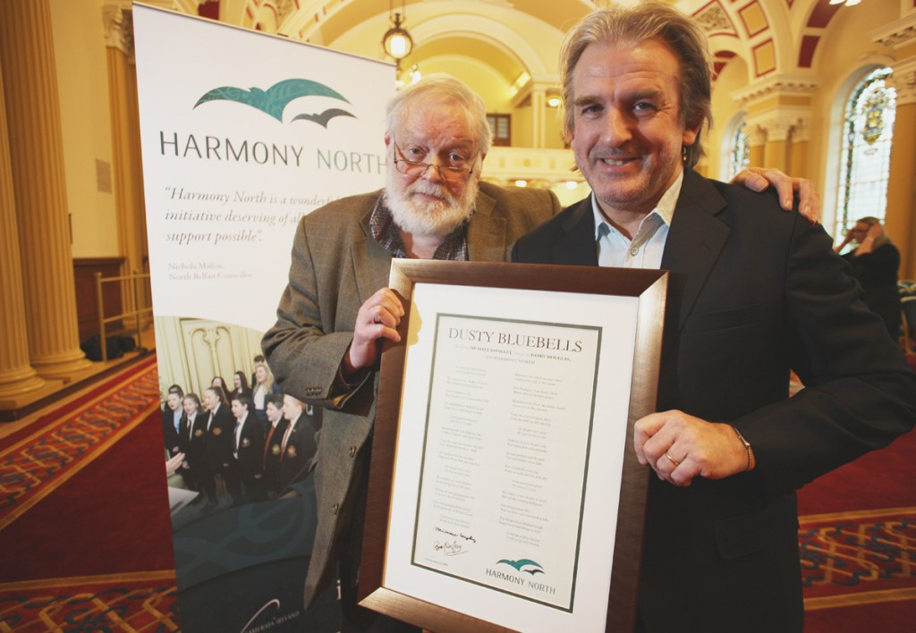 Belfast poet Michael Longley and  Barry Douglas with a singed copy of  newly commissioned Harmony North Anthem, ÔDusty BluebellsÕ at City Hall