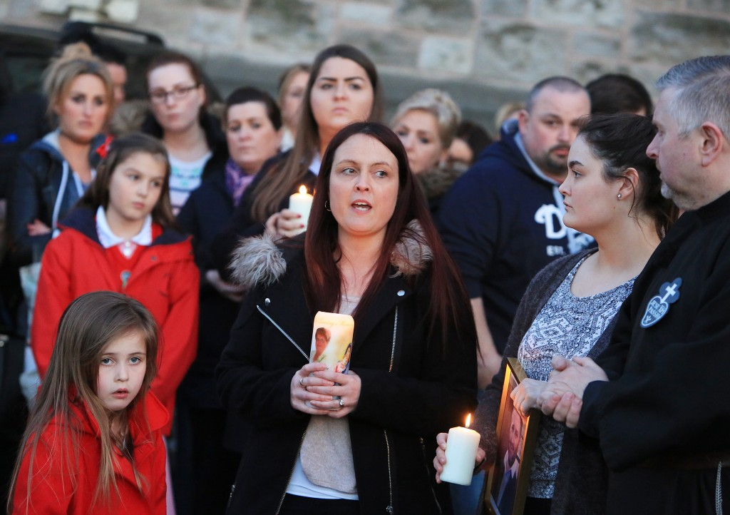 Joanne McGibbon addresses the crowd at the vigil to her murdered husband last week