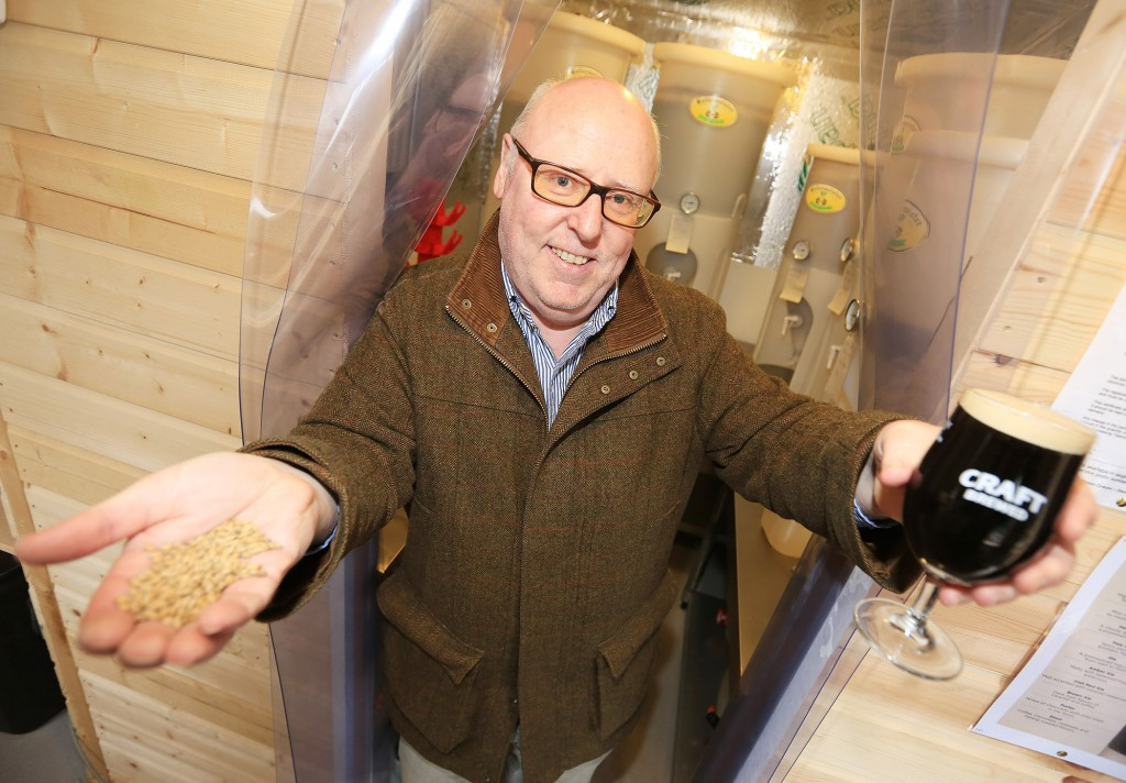Speckled Hen proprietor Martin Caldwell toasts the produce from his new Black Mountain Brewery Pic by Jim Corr