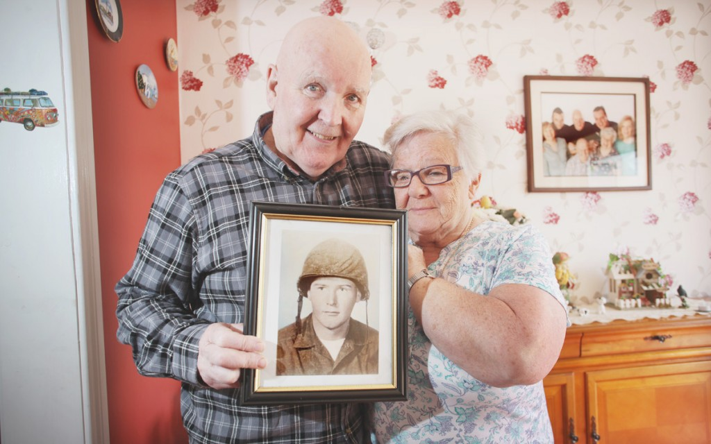 Billy & Bridie Brown stand with picture of Harry Brown who passed away last month