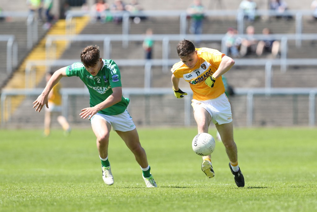 Antrim forward Liam Quinn, pictured in action against Fermanagh's Johnny Cassidy, will miss Sunday's Ulster MFC quarter-final tie against Donegal after breaking his ankle against the Ernemen