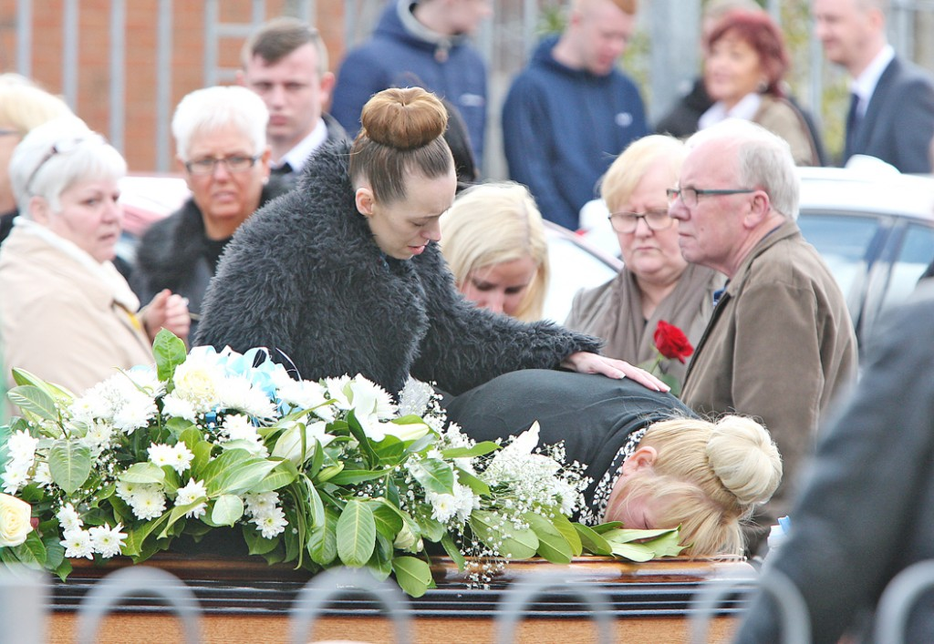 Aaron's mother Annmarie Strong kisses her son's coffin as it leaves Corpus Christi Church
