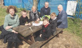 CAPACTIVE LEARNING: Culture Minister Carál Ní Chuilín and Gerry Kelly from Sinn Féin with classroom assistant Sharon Cairns, pupils Shea Maguire, Ryan O'Neill and Caiden Stewart and Principal Kevin McArevey at Holy Cross Boys School