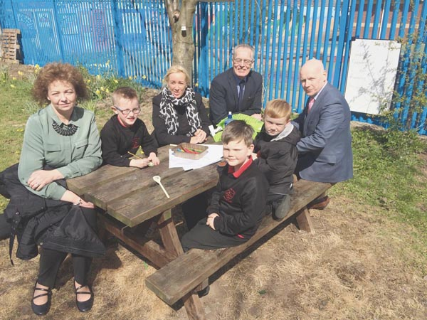 Culture Minister Car‡l N' Chuil'n and Gerry Kelly from Sinn FŽin meet with classroom assistant Sharon Cairns, pupils Shea Maguire, Ryan O'Neill and Caiden Stewart, and Principal Kevin McAreavey at Holy Cross Boys School