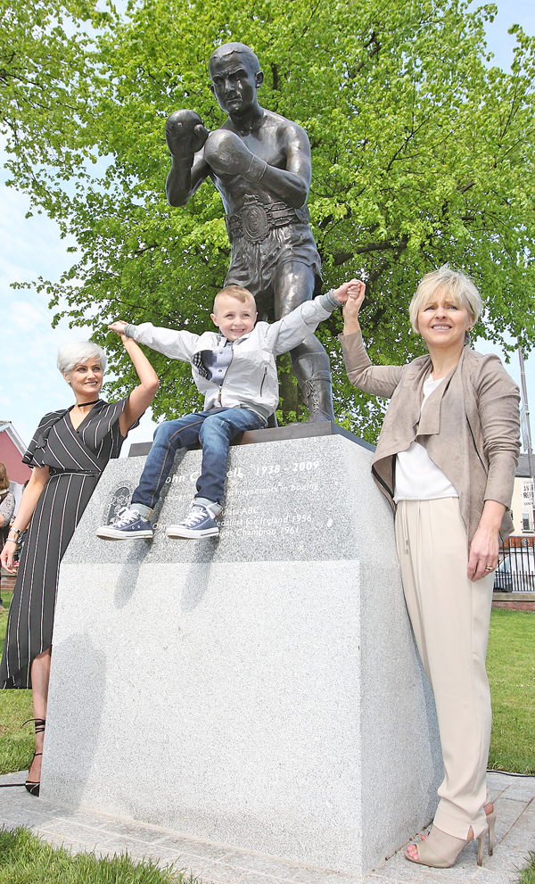 At the unveiling of a statue in Dunville Park of boxer Johnny Caldwell are his daughters Berna McStravick and Patricia Burns and his great grandson Paul