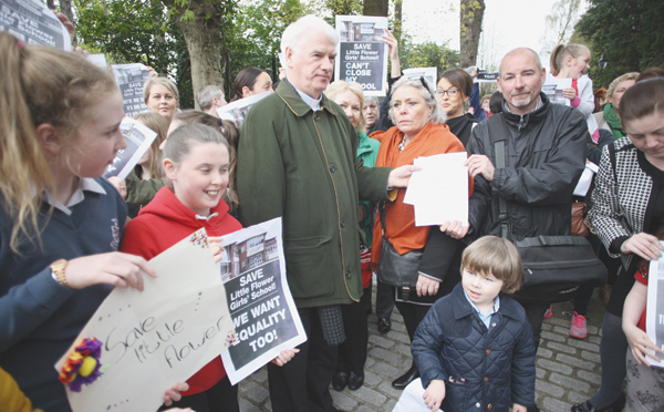 Fra Hughes hands over a letter of protest to Bishop Noel Treanor at his residence on the Somerton Road