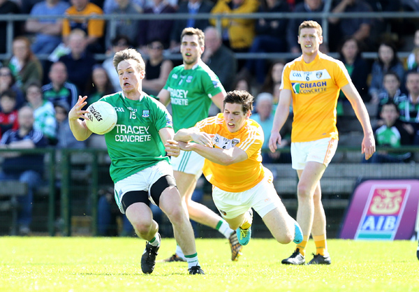 Tomás Corrigan of Fermanagh gets away from the challenge of Kevin O'Boyle