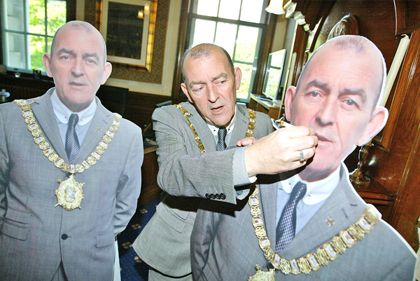 Arder Carson's last day as Lord Mayor of Belfast yesterday with two cardboard cut-outs of himself from his May Day picnic at City Hall