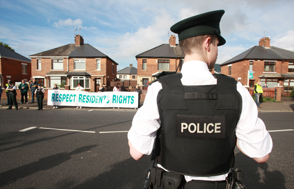 Residents protest at the annual Orange Order parade past nationalist homes on the Crumlin Road