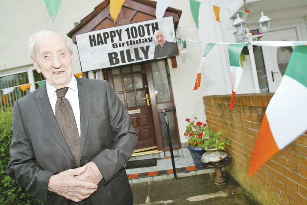Many happy returns: Billy Burns celebrating his 100th birthday in Ballymurphy this week