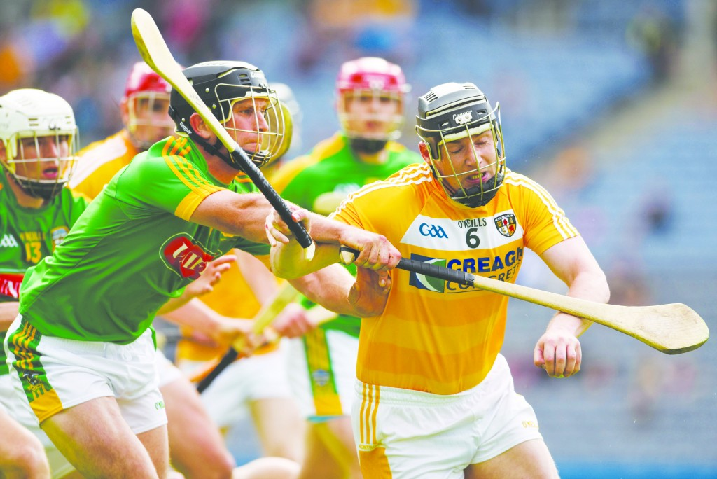 Antrim's Neal McAuley holds off the challenge of Meath's Joey Keena during last Saturday's Christy Ring Cup final in Croke Park