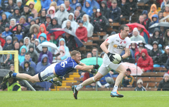 Tyrone's Colm Cavanagh breaks away from Cavan's James McEnroe during their drawn Ulster SFC semi-final. The Red Hands can beat the minus three-point handicap at Evens this Sunday at Clones