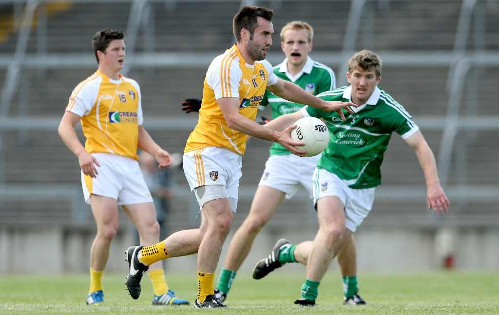 Antrim's Kevin Niblock gets away from Johnny McCarthy of Limerick during the Qualifier clash in the Gaelic Grounds in 2014. The sides meet again in Corrigan Park on Saturday