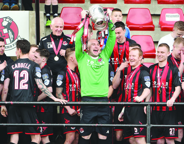 Sean O'Neill, pictured lifting the Gibson Cup with Crusaders, has been drafted into the Antrim senior football squad