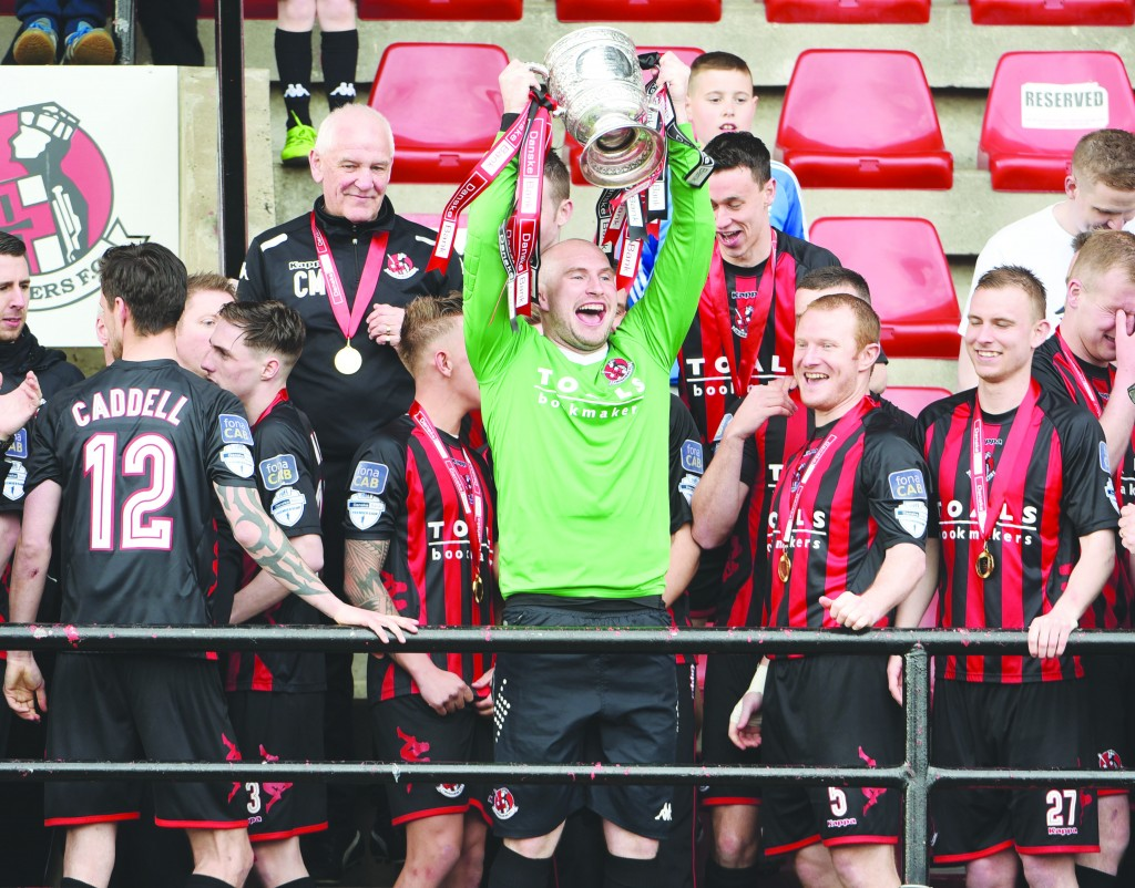 Sean O'Neill, pictured lifting the Gibson Cup with Crusaders, has been drafted into the Antrim senior football squad for the forthcoming All-Ireland Qualifier campaign. The Saffrons have been handed a home draw against Limerick in Round 1B
