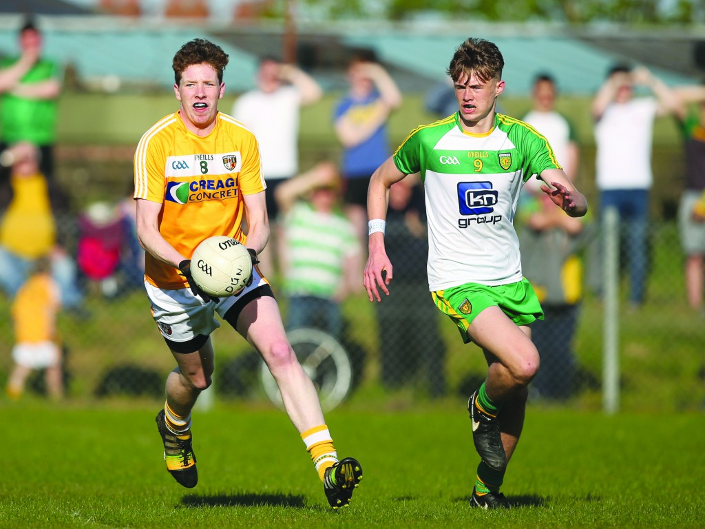 Niall McKeown looks to avoid the attention of Donegal's Kieran Gallagher on Sunday evening
