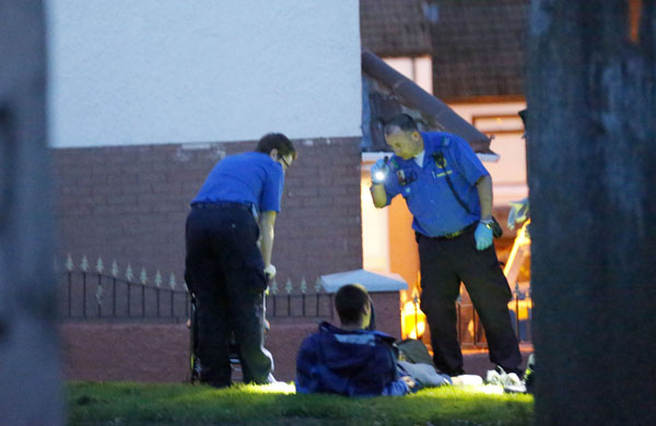 The injured man is treated by paramedics. Picture by Kevin Scott