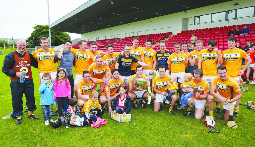 The Antrim squad celebrate with the Liam Harvey Cup following their 13-point win over Armagh in Sunday's Ulster SHC final at Owenbeg