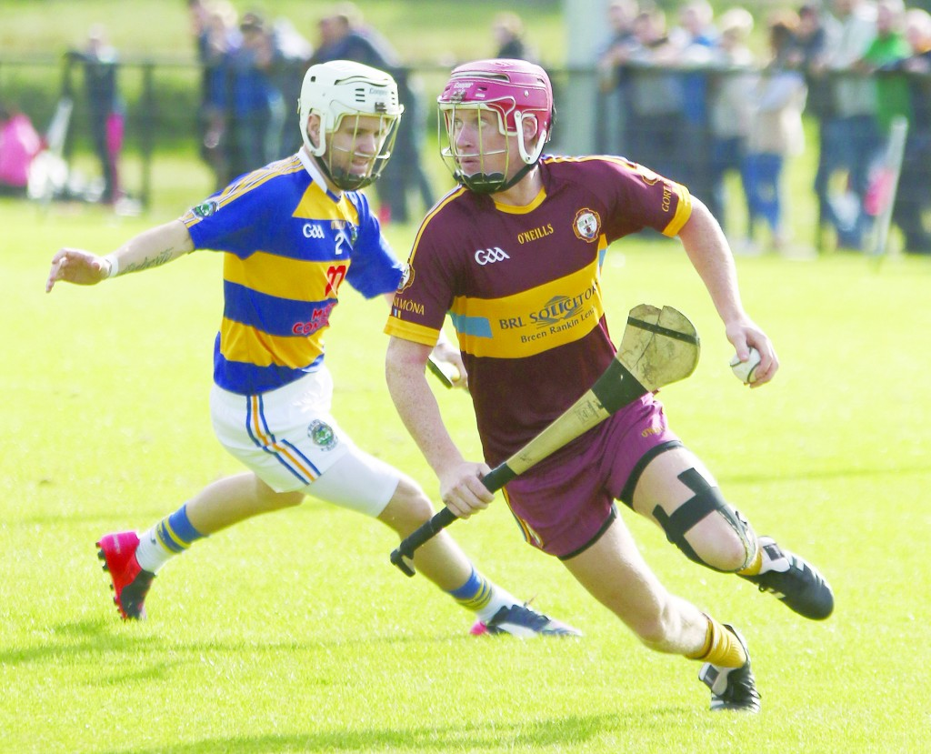 Gort na Móna forward Desy McClean shows Rasharkin's Daniel Doherty a clean pair of heels during Saturday's Championship clash in Ahoghill. The Turf Lodge men progressed with a nine-point win but the former Antrim star knows more will be needed when they take on Cloughmills this Sunday in the next round
