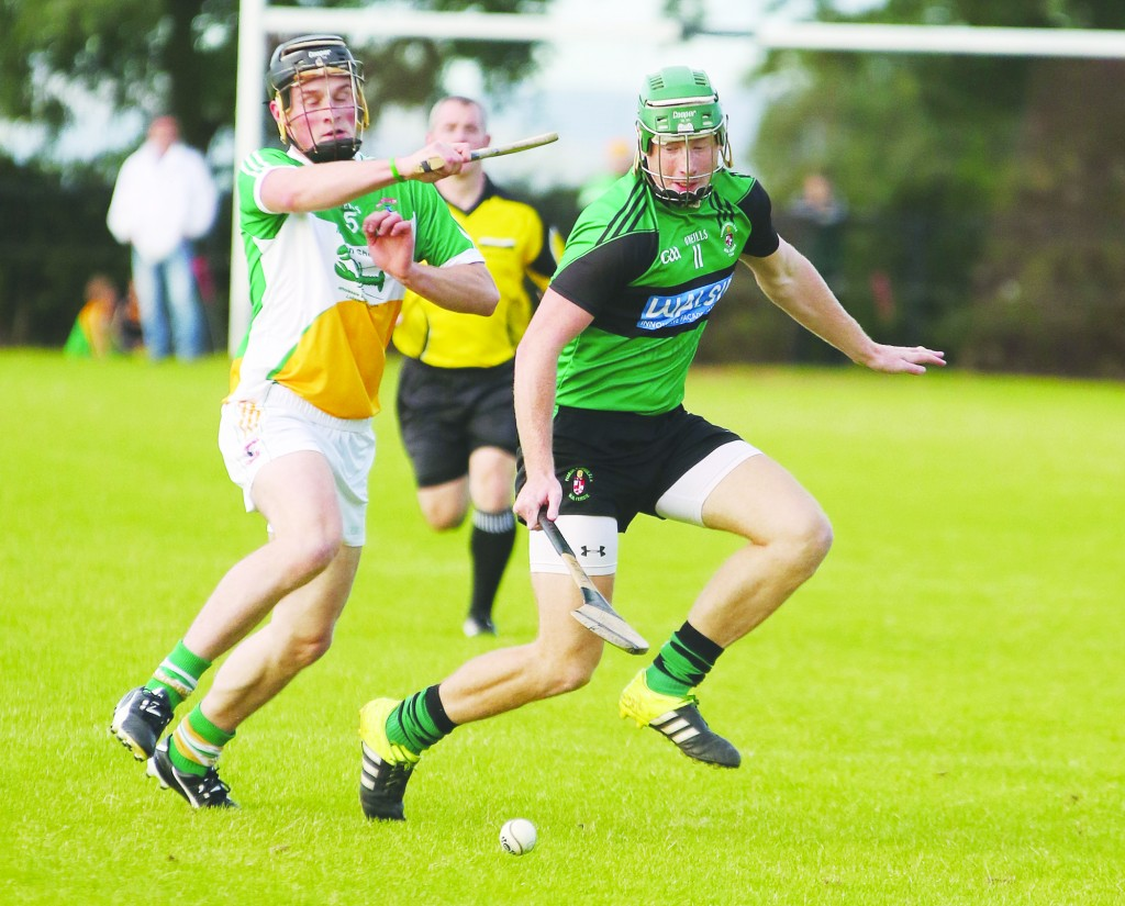 Sarsfield's attacker Niall McKenna battles for possession with Glenariffe defender Conor Patterson during last Saturday's IHC clash in Ahoghill