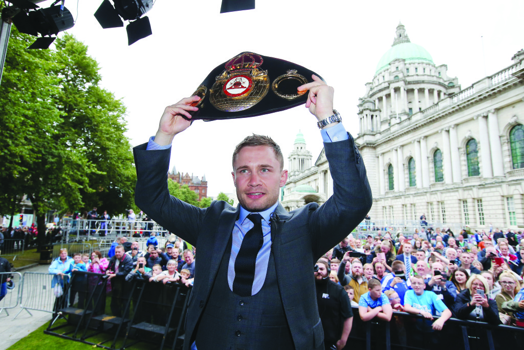 Carl Frampton shows off the WBA featherweight title belt he won in New York on July 30