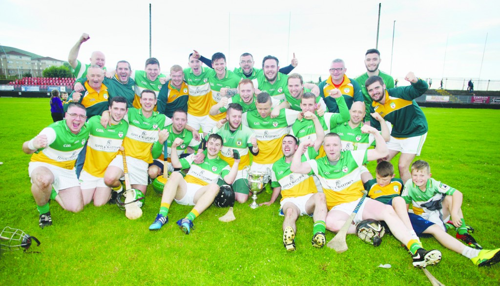 Michael Davitt's celebrate after retaining the Antrim Junior B Hurling Championship with a narrow one-point win over St Agnes' at Sarsfield's on Saturday night