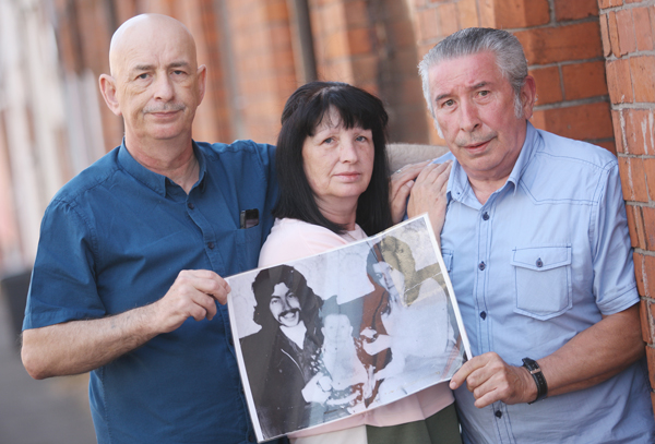 Paddy, Esther and Hugh Dempsey with a treasured portrait at the family home in Hillman Street