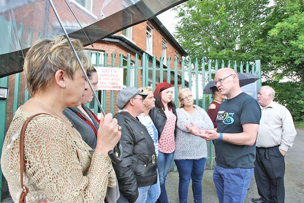 : MEETING: West Belfast MP Paul Maskey talks to residents from Regina Coeli Hostel