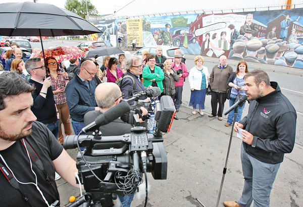 SHOWCASE: Harry Connolly from Fáilte Feirste Thiar speaking at the unveiling of the 1916 mural at the International Wall