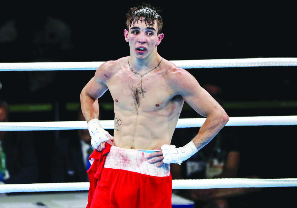 Michael Conlan removes his amateur vest what what is likely to be the last time following the judges' decision not to award him Tuesday's Olympic quarter-final against Vladimir Nikitin