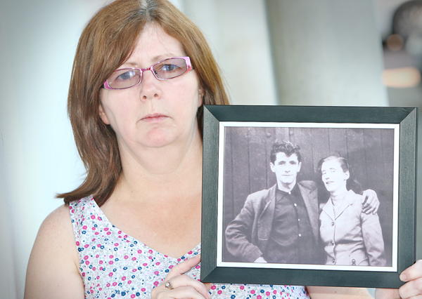 REUNITED: Janet Donnelly with a treasured portrait of her mum and dad, Joseph and Mary. The double burial today will be a bittersweet affair for the family