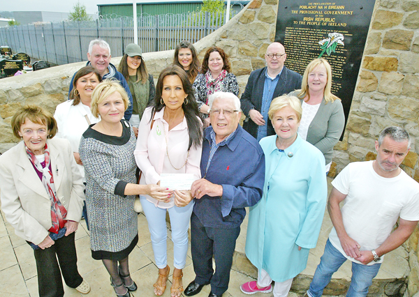 Women from the Still Imprisoned Project who presented Dessie Kennedy and representatives of the National Graves Association with a cheque  towards the cleanup of the Republican plot in Milltown Cemetery.