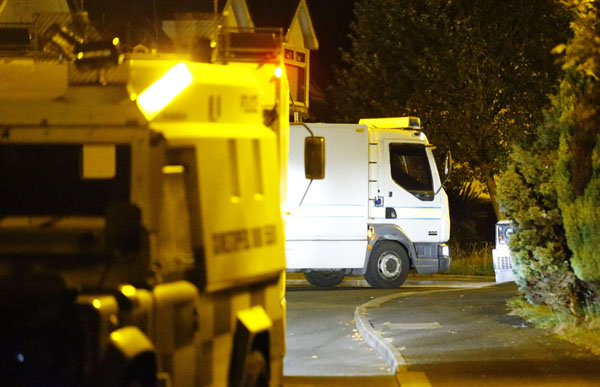 Police mount an operation in Lagmore in connection with the Lisburn bomb find
