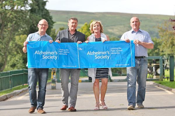 Paul Maskey, Caoimhin Mac Giolla Mhin, Patricia Kennedy McDonald and Malachy McDonald warming up for the Alzheimer's Society walk in the Falls Park