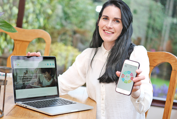 Debbie Craig pictured with 'Boop' her new autism website and app