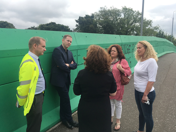 Minister Chris Hazzard visited Finaghy Bridge to hear for himself the thoughts of local representatives and residents