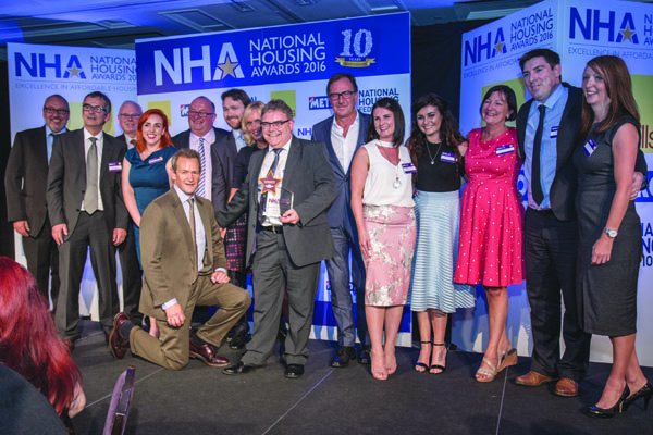 Newington Housing Association celebrate their award at the National Housing Awards 2016 in London with host Alexander Armstrong