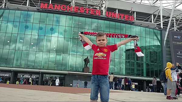 FOOTBALL FAN: Nine-year-old Sean McKinney outside Old Trafford in Manchester