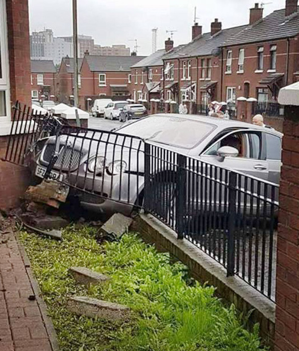 The Silver Bentley smashed into the garden wall of a house in West Belfast on Saturday afternoon.